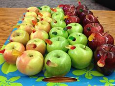 """Sorry kids, but the apples are a little wormy: a healthy snack for my son's class. I used a cleaned stainless steel 3/8"""" drill bit and drilled holes in 32 apples. I rinsed the holes then filled the holes with gummy worms. The kids loved it!"""