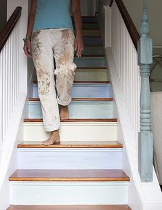 Playful, creative and subtle use of colour for a challenging feng shui area (staircase); feng shui staircase tips here: http://fengshui.about.com/od/fengshuihouseplantips/f/feng-shui-staircase-cures.htm Slows down the energy - you want that in a stairway! -  in a soft, playful and soothing way :-)