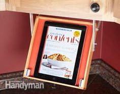 Drop down tablet tray for the kitchen.. Keeps it out of the way but visible when following a recipe