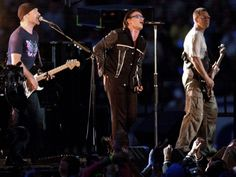Super Bowl XXXVI (Feb. 3, 2002) |  The Edge, Bono and Adam Clayton of U2 perform during the halftime show of Super Bowl XXXVI at the Louisiana Superdome in New Orleans.