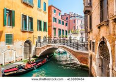 Scenic canal with bridge and colorful buildings in Venice, Italy