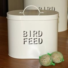 Cream Enamel Metal Bird Food Storage with Scoop by The Contemporary Home, http://www.amazon.co.uk/dp/B000H9HS8Q/ref=cm_sw_r_pi_dp_YwMorb0AGCH2D