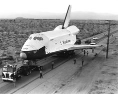 The space shuttle Enterprise is transported 36 miles from the Rockwell factory in Palmdale, California, to Edwards Air Force Base on 31st January 1977.
