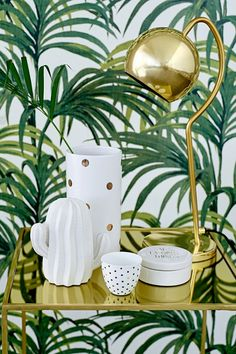 gold bar cart, gold table lamp, white and gold ceramics and leaf print wallpaper… Interior Tropical, Tropical Home Decor, Tropical Design, Tropical Style, Tropical Houses, Tropical Prints, Estilo Tropical, Tropical Bedrooms, Interior Decorating