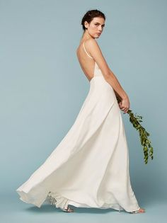 How babes get married. This is a floor length, fitted, backless dress with a crew neckline.