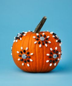 Candy and a glue gun is all you need for this graphically designed pumpkin.