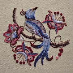 Crewel work refers to the traditional hand embroidery technique which uses wool threads on a background of linen twill. This bird of paradise design is based on