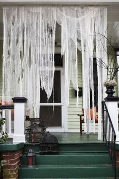 Hang tea stained cheese cloth for a haunted entry way