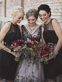 Adding a sheer black floral layer to a traditional white wedding gown is the perfect way to create a unique look.