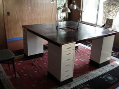 great idea for a craft room table all those drawers make for lots of storage