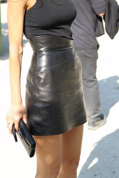 high-waisted leather skirt paired with black tank (add jewelry and color pop heels for a more sophisticated look).
