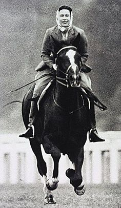 Queen Elizabeth II galloping at Ascot in 1964