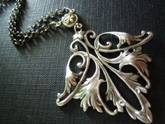 """""""Antique Sterling silver plated sturdy brass art nouveau lily flower necklace,N304. $29.00, via Etsy.""""  I'm typically not in the mood for something this large, but I do like it."""