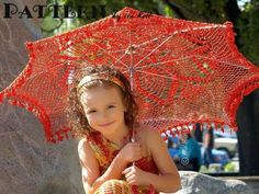 Ira Rott sells the #crochet pattern for this pretty red parasol. Great for getting some shade from the summer sun.