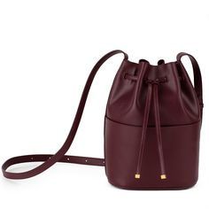 A diminutive design inspired by our coveted Oversized Bucket Bag, this mini masterpiece is crafted in Italy from textured Saffiano leather. This piece embraces functionality and divinely placed details, like an adjustable shoulder strap, front pocket and touches of gold hardware. This beautifully feminine bag will see you from day to night.