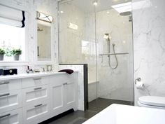 This stylish and contemporary master spa features a large walk-in shower equipped with steam, digital controls, rain showerhead, and more on HGTV.com.