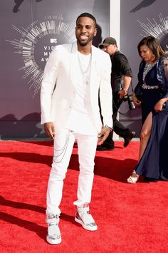 Recording artist Jason Derulo attends the 2014 MTV Video Music Awards in a white suit. via @stylelist | http://aol.it/YVTlKX