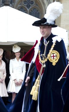 Britain's Catherine, Duchess of Cambridge watches as Britain's Prince William, Duke of Cambridge passes during the annual Order of the Garter Service at St George's Chapel, Windsor Castle, Windsor, June 18, 2012. REUTERS/Paul Edwards/Pool