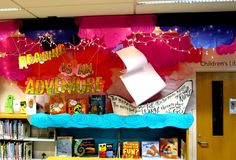 """""""Reading is an Adventure"""" is a visually stunning library display!  On the ship, Rachel Moani has written a popular line from """"I Can Read With My Eyes Shut!""""  by Dr. Seuss:  """"The more that you read, the more things that you'll know. The more that you learn, the more places you'll go."""""""