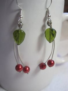 Red glass pearl and glass leaf beaded jewelry. Wear these to hit a jackpot on slots! Handmade Beaded Jewelry, Tassel Jewelry, Jewelery, Cherry Earrings, Bead Earrings, Chakra Jewelry, Girly, Diy Jewelry Making, Artisan Jewelry