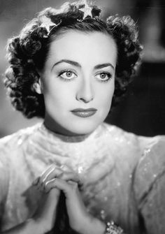 The great actrees #JoanCrawford it in old photo of the year 1937