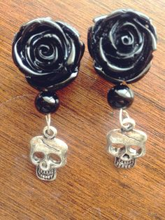 Hey, I found this really awesome Etsy listing at http://www.etsy.com/listing/155941703/black-skull-plugs-handmade-gifts