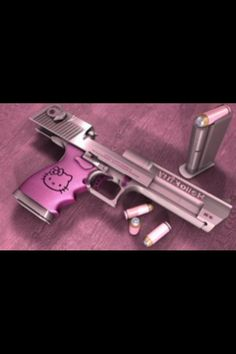 I like this pink gun minus the Hello Kitty. Pink Bullets do they really make those??