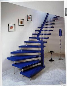 Tasteful Example of Modern and Traditional With This Semi-Spiral Blue #Staircase. -CanadianHomeTrends
