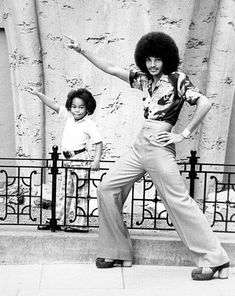 Never mind the tight 'fro. Dig that little kid sporting a serious James Brown 'do.