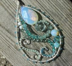 Aqua, sea green, and opalescent silver swirl medallion necklace with opalite, apatite, mystic quartz, pearls