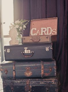 vintage luggage for cards and programs and DESTINATION BOXES:  http://www.dreamanddress.com/2011/01/diy-destination-boxes.html
