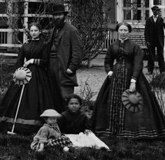 Croquet 1860s style. This looks earlier than most croquet pictures - no lifted skirts, no elliptical shapes visible.