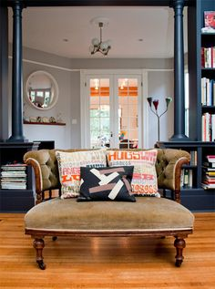 I love the idwa of doing a huge bookshelf system in lieu of just a wall between 2 main living areas. Phil and Steph Dickinson's Portland home. Design by VanillaWood. Photo by Leela Cyd Ross Living Area, Living Room Decor, Living Spaces, Living Rooms, Style At Home, Modern Victorian Homes, Victorian House, Victorian Books, Art Deco