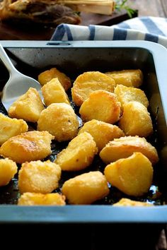 Truly Crunchy Roast Potatoes - this has a really thick, crunchy crust! Par boil, rough up the surface, dust with semolina then bake in a very hot oven in preheated oil. Based on a Nigella recipe.