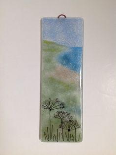Fused glass wall panel landscape with seed head silhouette. #fusedglass #artglass #wallart #glassart www.firedcreations.co.uk