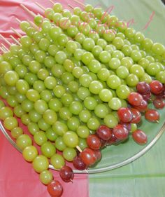 very hungry caterpillar party -- grape caterpillars (could also use strawberries or cherries on the ends)