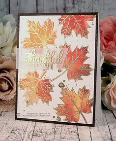 handmade Thanksgiving cad from Snappy Scraps ... maple leaves in bright Fall colors with outlines and veins heat embossed in gold ... sentiment on vellum ... beautiful!