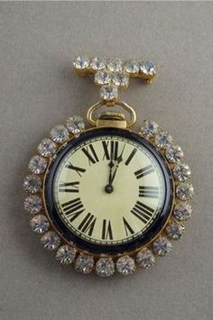 U053. Vintage 1940's Pocket Watch. This unique pin consists of an antique pocket watch surrounded by vintage rhinestones.