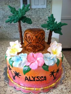 Hawaiian themed cake - Birthday cake for 11 year old girl having a Hawaiian themed party, tiki is cake, flowers are gumpaste, palm tree's are tootsie rolls and candy melts, and base cake was airbrushed and then handpainted. TFL!