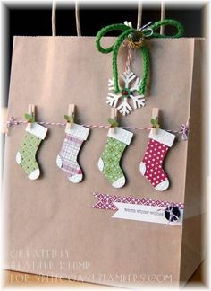 What a sweet way to decorate a plain paper bag for Christmas.  Would work beautifully as a card design, too.