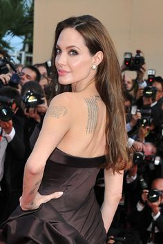 Angelina Jolie at event of The Tree of Life. Angelina in sexy dress. How beautiful is this woman. Amazing color of the eyes.