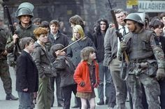Children taunt a British soldier in Londonderry, Northern Ireland after an explosion in city centre on 13 April 1972