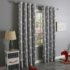 Cute curtain panels for an outerspace themed boys bedroom with white stars on a grey panel. Comes in several colors.