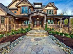 Craftsman Masterpiece with Studio - 23290JD | Architectural Designs - House Plans House Plans Mansion, Dream House Plans, Vaulted Living Rooms, Craftsman Style House Plans, Craftsman Houses, House Elevation, Front Elevation, Level Homes, Log Homes