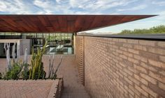 Patterned brick walls define this Arizona home by A-I-R Architects, providing residents with a variety of indoor and outdoor living spaces amongst the desert landscape