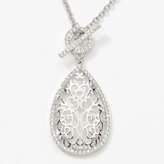 """One of my favorites from the new Spring/Summer '15 collection! Wore it today with a pink rounded neck sweater and jeans!  Lacework Pendant Item 3828NF Versatility Crystals border this intricate design; rhodium plating; 31"""" to 34"""".  Double the chain for a shorter look!  $79.00  Nadia Madjidi's Personal Website www.touchstonecrystal.com/nadia"""