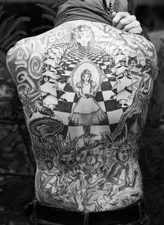 This is a grownup version of the Alice in Wonderland tattoo. It may not be essentially true to our childhood memories of this wondrous story. But the way it has been done is something that will make you want to gaze at it for a long time.