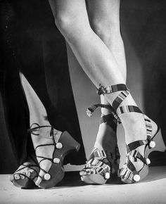 Women wearing unrationed shoe soles during the war.  Location:	US  Date taken:	1943  Photographer:	Nina Leen