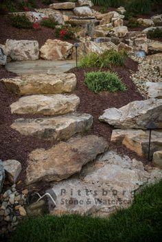 Landscaping boulders stone hardscapes sloped backyard landscaping, sloped y Landscaping With Boulders, Landscaping A Slope, Landscaping Retaining Walls, Landscaping Ideas, Mailbox Landscaping, House Landscape, Landscape Design, Garden Design, Landscape Bricks