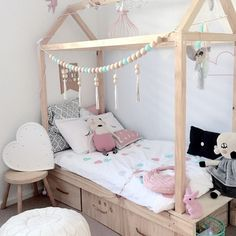 cute little girls room -- kids house bed with storage drawers underneath and a wood bead garland via mintinteriordesign